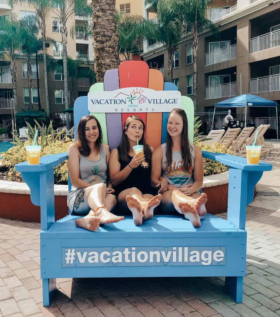 Me and three friends in a giant beach chair at Vacation Village